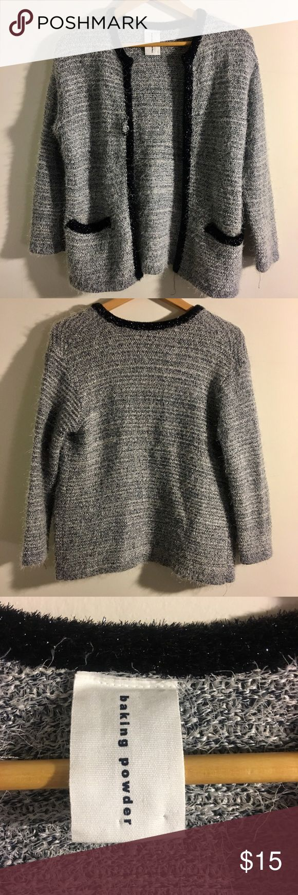 Gray Knit Cardigan with Metallic Hem Super cute gray knit cardigan sweater with a black metallic trim on hems. Small 1 inch tear at Hem near shoulder, pictured, priced accordingly. Worn a few times, still in like new condition! Baking Powder Sweaters Cardigans