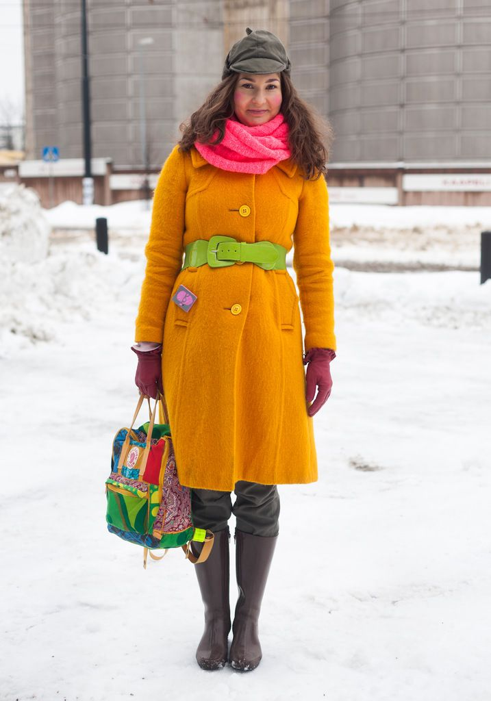 """Aino, 31  """"Im allergic to the colour black. I always wear bright colours.  Style should be fun and playful, not a serious business.  Now Im wearing second hand, old Nokia rubber boots with a self-modified backbag."""""""