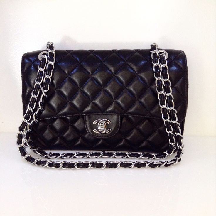 Classic Chanel Medium Flap Bag with quilted leather and silver hardware. Great condition!Please call (949)715-0004 for inquiries.