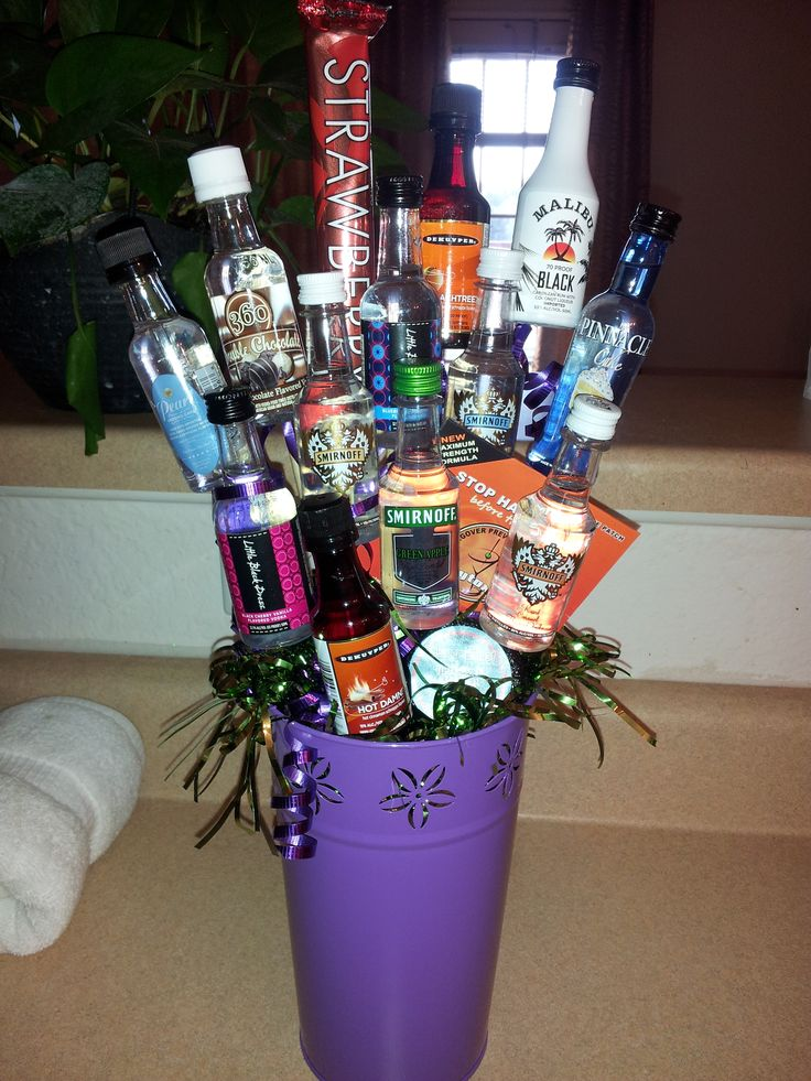 Purple 21st birthday liquor bottle bouquet with a hangover patch and hangover shower burst and also an strawberry liquor ice popsicle