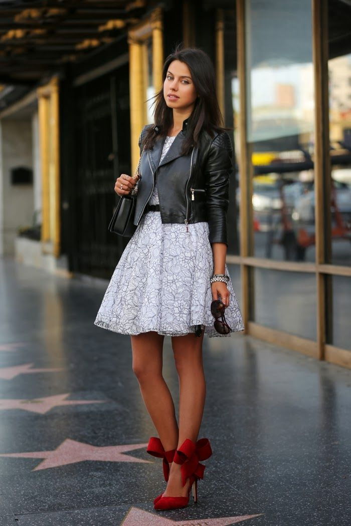 black white flare dress + black moto jacket + red bow pumps