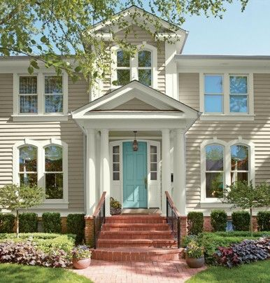 Like the idea of a bright door-Make your front door fresh and inviting! via The Washington Post.. love the house color and door in this pic!