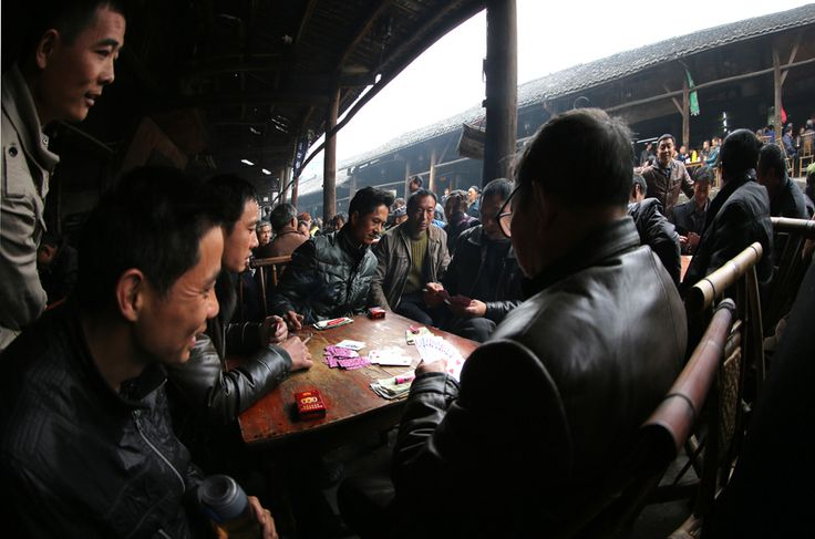 Many tables are laid out every morning for card games in the verandah of teahouses in this old section of Luocheng Town . The street is named ' Boat-shaped Street ' simply because it vaguely resembles a boat when viewed from a high angle .