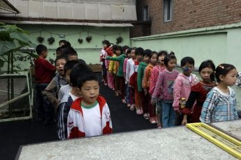 Students at the Tongxin Experimental Primary School line up during morning assembly on the outskirts of Beijing, China.