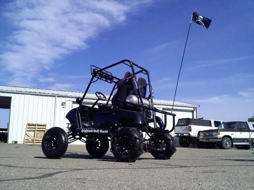 Lifted Golf cart Highland Golf Carts custom lifted golf car. It is a 1998 Yamaha G16 with a snowmobile motor...!