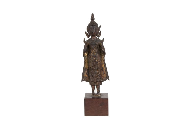 Description A standing figure of Buddha. Thailand, lacquered and gilt bronze, later wood stand.  Date 19th century  www.collectorstrade.de