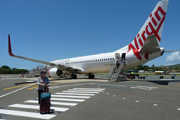 Boarding a Virgin Australia Airplane on Hamilton Island, Australia. Note that we had to walk onto the tarmac and boarded through the rear door of the airplane.