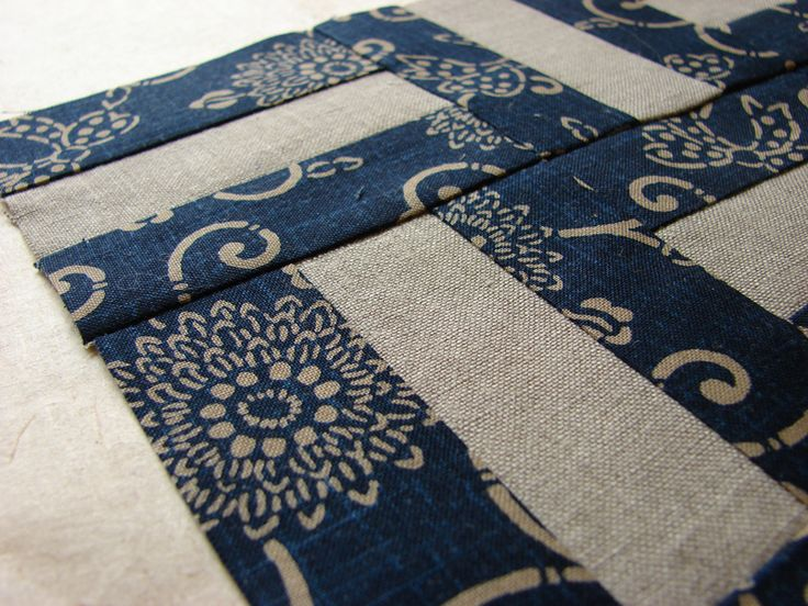 Lightweight Japanese indigo quilts look great folded over the end of a chaise or over the arm of a chair or sofa.