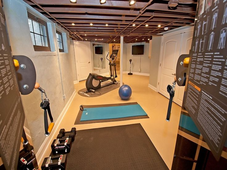 Traditional Home Gym with Theraband Mat - 40 x 75 x 0.6, specialty door, tv wall mount, Built-in bookshelf, Exposed beam
