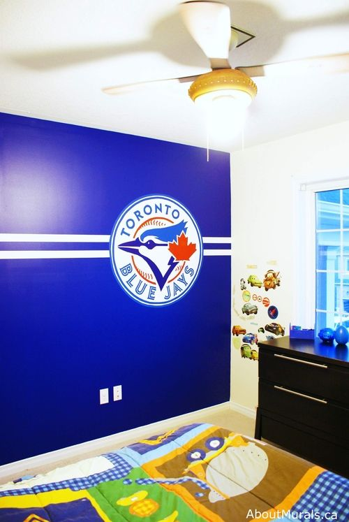 What a cool way to celebrate your fave sports team!  This Toronto Blue Jays baseball wall mural was hand-painted as a surprise birthday gift.  He went nuts for it!