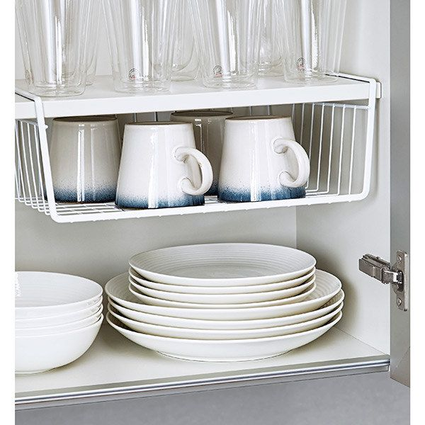 A basket that attaches to the bottom of shelves for extra storage.