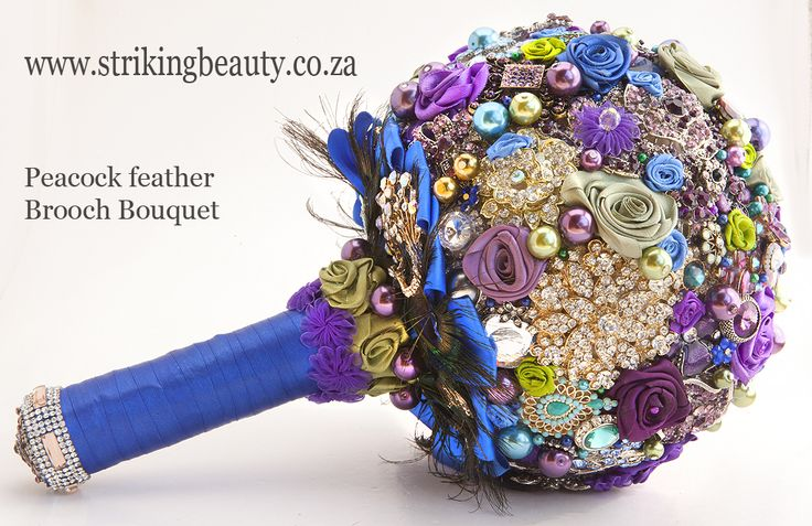 Peacock feather brooch bouquet - intricately made with great attention to detail. Gorgeous jewellery added.  See web   www.strikingbeauty.co.za for more photos and details