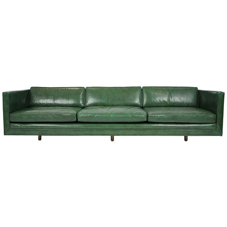 Tuxedo sofa with all original dark green leather upholstery designed by Harvey Probber. Circa early 1950s. | From a unique collection of antique and modern sofas at http://www.1stdibs.com/furniture/seating/sofas/