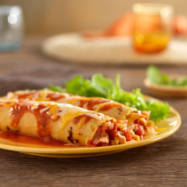 RO*TEL Spicy Chicken Enchiladas: Shredded rotisserie chicken spices up dinner in a flash tonight.