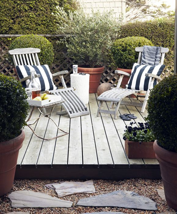 striped pillows on the patio, wood planks and chairs