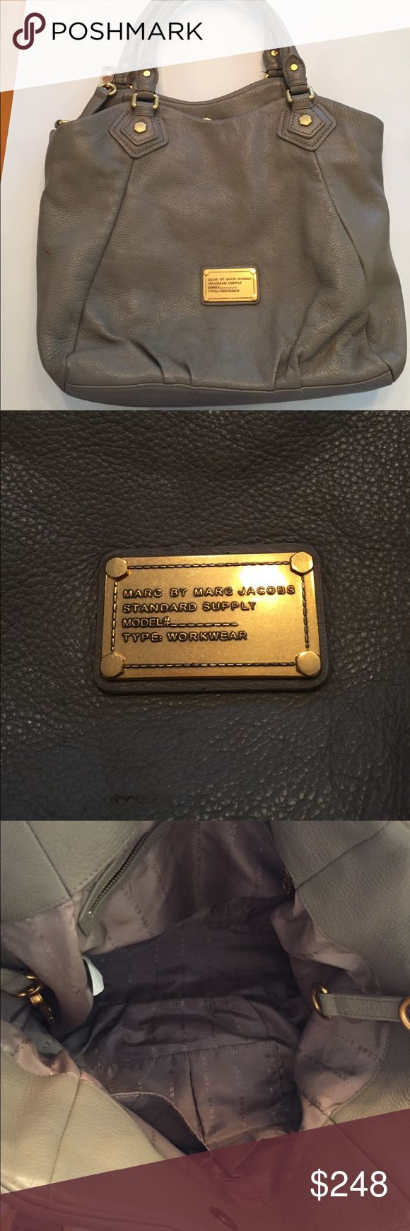 Marc By Marc Jacobs grey handbag!  Gorgeous Marc By Marc Jacobs grey hand bag. This hand bag is made with the softest leather. The grey color is so neutral that it can be worn all year round. It is in excellent condition. Marc By Marc Jacobs Bags Shoulder Bags