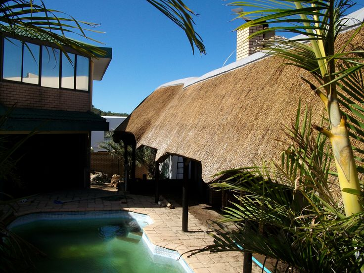 This large thatched lapa by the pool creates shelter and outdoor entertainment space whatever the weather