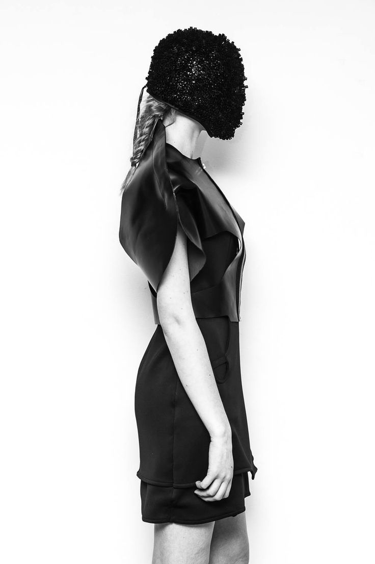 """""""The Black Dress"""" with straw mask. Inspired by dinosaurs. By Christine Andresen for Antidote."""