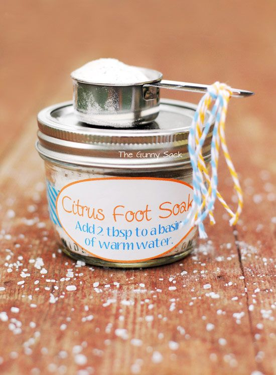 1/2 cup of baking soda, 1/3 cup Epsom salt, the contents of 2 orange tea bags and 5 drops of orange essential oil. Put it all in an 8 oz mason jar or a bowl and stir it up. Add 2 tablespoons of the foot soak to a basin of warm water and soak your feet while you relax! If you are giving the foot soak as a gift, add a scoop and tie a few pieces of colorful baker's twine to the end.