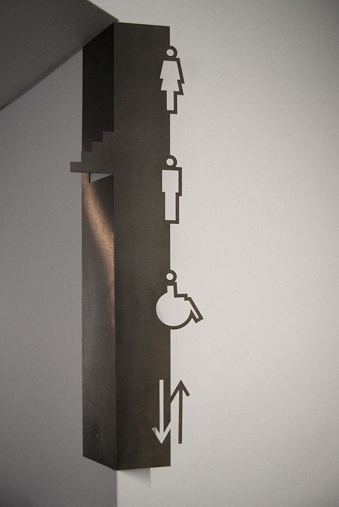 simple bathrooms, stairs and directional arrows in a metal punched sign #signage #graphicdesign #minimalist