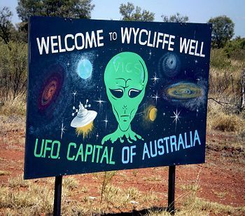 Wycliffe Well, Australia. Apparently there is a stretch of road through the Nullarbor Desert that has legit warnings of UFOs. I'd love to camp overnight there. Come on, it's a bucket list thing!