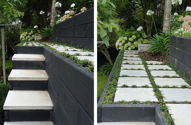 Black & white steps leading up to concrete pavers & mini mondo grass.  Designed by Rach Matthews, HEDGE Garden Design & Nursery