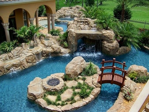 Beau Awesome Natural Look Pool With Several Waterfalls, A Bridge Andu2026looks Like  A Gas Fire Pit. Water By PattySquirell On Indulgy