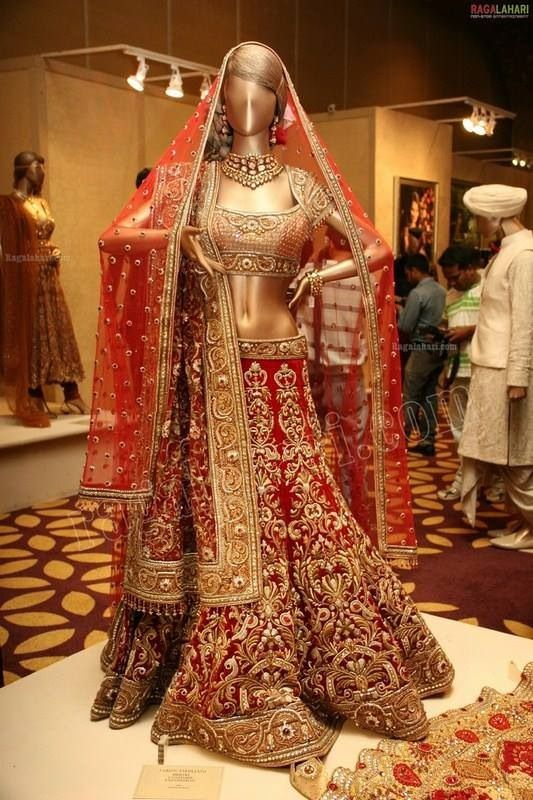The perfect red lengha wedding dress for an authentic desi bride.
