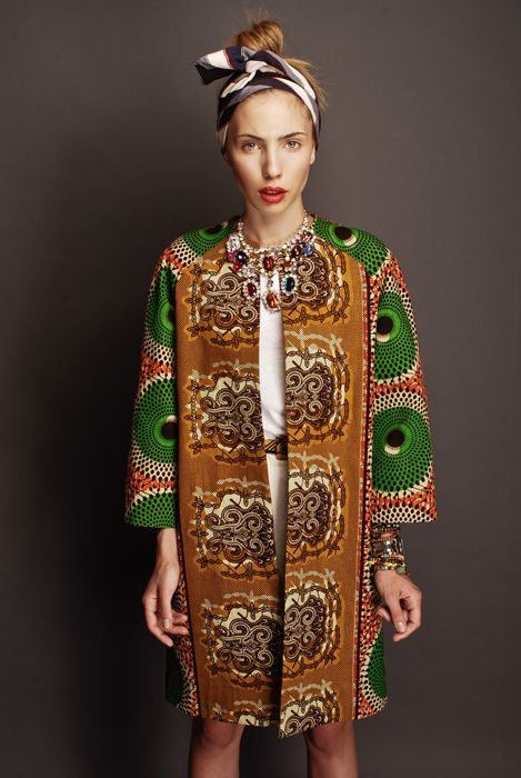 Stella Jean is an Italian based designer of mixed Haitian and Italian lineage...she designs amazing clothes using traditional African fabrics and takes them somewhere different all together...love this fabulous coat with oversized print