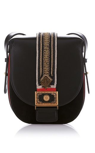 Small Postman Bag by ETRO.  Fabulous details on this stylish yet unusual bag. Love.