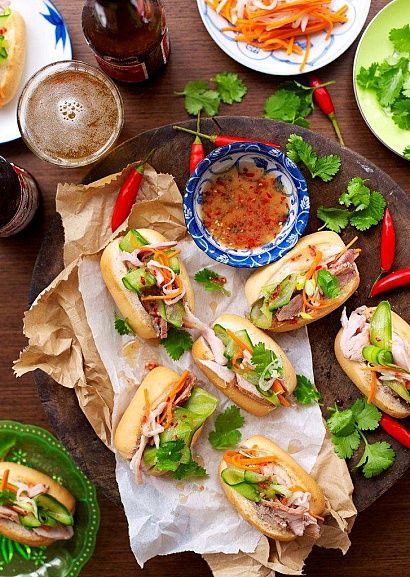 Banh Mi: Ingredients ― rolls; chicken liver pâté; roast pork; cucumber; shallots; cilantro; pickled vegetables ~ cilantro; rice vinegar; sugar; salt; daikon; sweet peppers; carrots; for the sauce ~ carrots; fish sauce; rice vinegar; chili; garlic; sugar. Instructions ―  Prepare pickled vegetables. Prepare the sauce. Spread pâté on each ½ bun; add pork & cucumber; top with vegetables; toss onion & coriander with ½ the sauce, place on the sandwiches. Serve with remaining sauce.  #Banh_Mi