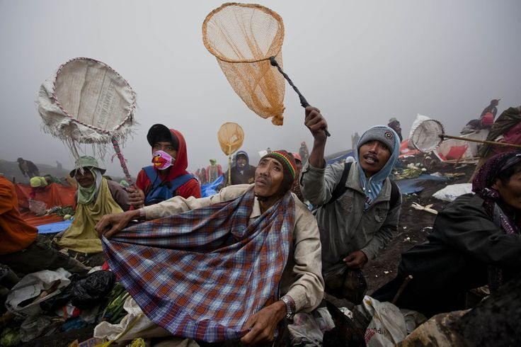 RELIGIOUS GUIDES? Villagers prepared to catch offerings thrown by worshipers near the Mount Bromo volcano crater during Yadnya Kasada celebrations in East Java, Indonesia, Wednesday. During the festival, the Tenggerese people throw offerings in the crater for the gods | © Ulet Ifansasti | Getty Images