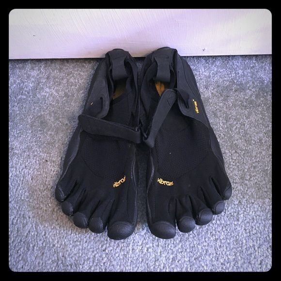 Vibram five fingers shoes Five fingers shoes, selling because they're too small! I have another pair the exact same size and they fit great, so this pair must run a bit small. Would fit someone that's a size 39 (9 us) usually. This is labeled a size 40. All black with yellow branding and insole. In excellent like-new condition, only worn once! Clean and ready for a run or for use as water shoes. Make me an offer! Vibram Shoes Athletic Shoes