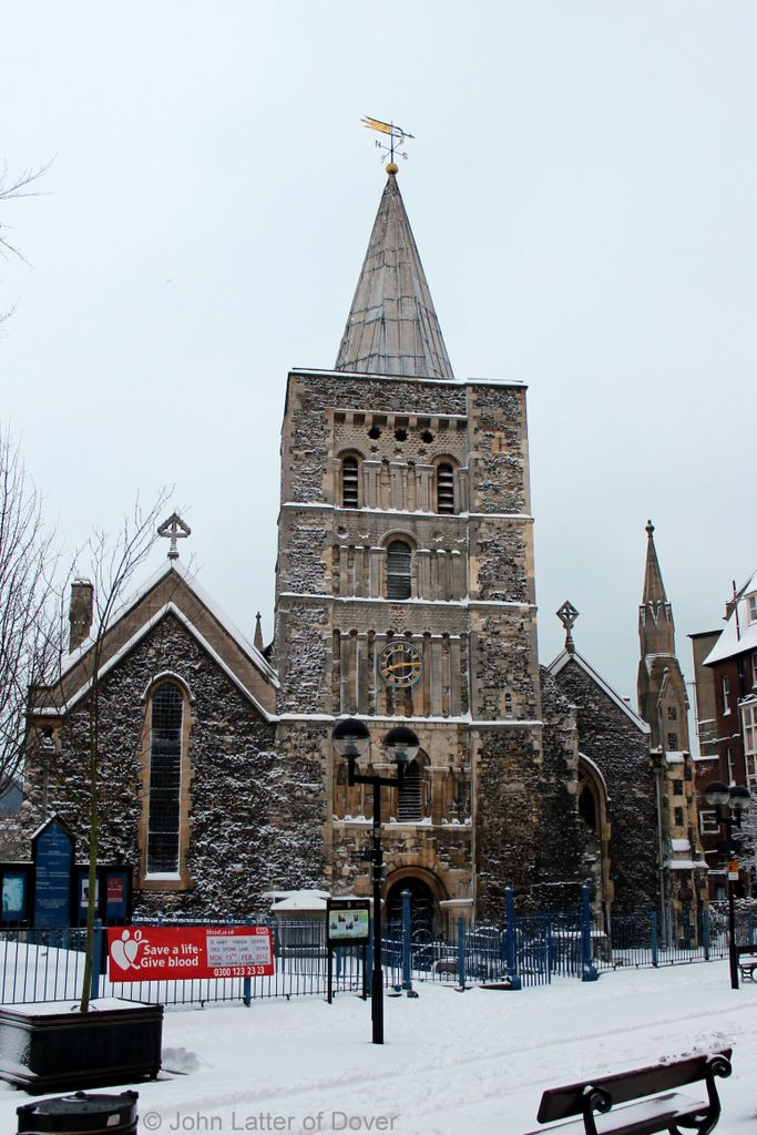 Church of St Mary the Virgin in Winter, Dover, Kent, England, UK: Bell Tower, weather vane, and clock of St Mary's parish church and snow. Church of England, CofE Listed Building. Lady Chapel in left-hand aisle, Organ in right. Tower sundial not in shot. Originally a Roman site: Saxon church burnt 1066, Norman church built pre-1086; Victorian restoration 1843-1844. Located Cannon Street, CT16 1BY. Urban Dover Architecture and Medieval History. See: http://www.panoramio.com/photo/99154939: Church Burnt, Victorian Restoration, Restoration 1843 1844, Dover, Weather Vane, Church Built, Built Pre 1086, Mary