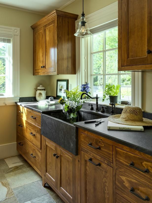 If I decided to go with wood cabinets, this is exactly what i would want!! beautiful kitchen with wood cabinets and black countertops and apron sink (via…