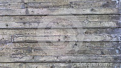A shot of a modern wooden wall covered in a layer of concrete from the local park.