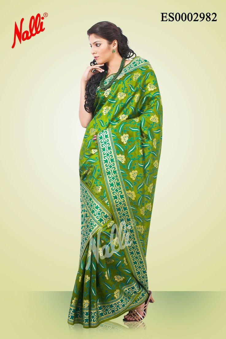 #Green Banaras #Dupion Silk Saree with Thread Embossed on body and #Zari border. Includes Unstitched Blouse.The price of this saree is Rs 3839/- . To shop online click the link below http://www.nallisilks.com/store/sarees/ethnic-wear/banarasi/green-banaras-dupion-saree-silk-saree