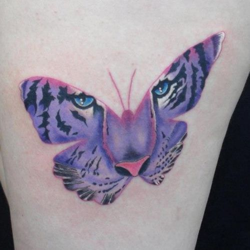 Сharming Tiger Butterfly Tattoos -    The showy tiger butterfly tattoo inscribed on the thigh. The black-yellow color gamut conveys realistically the tiger image, and the deep black outline imitates accurately the butterfly's silhouette. The acid-green eyes is what appeals …