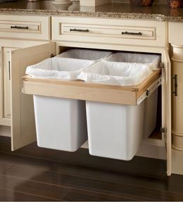 Wastebasket / Recycling Center Cabinet.  Keep your trash and recycling hidden and neatly organized with four separate bins.  By KraftMaid Cabinets available at JustCabinets.com