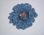 Light blue felt flower brooch with wool threads