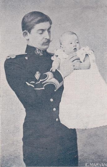 Crown Prince, later king, Ferdinand of Romania with his eldest child, Prince Carol.