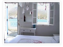 Studios Amfitriti - Serifos, Greece - Just five minutes from the Livadi port are these studios that feel more like staying at a really cool Greek friend's house than a hotel. Each room is adorably decorated and themed, like the sea bottom room with white sails hanging from the ceiling and a drawn mermaid on a reclaimed white wooden door. This is great for those looking for a more casual yet still beautiful stay in a place with a lot of character.