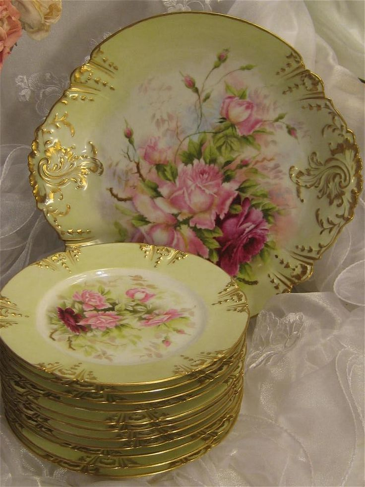 Limoges platter and smaller plates, with hand painted pink roses on yellow background, and scalloped edges trimmed in gold, ca 1900