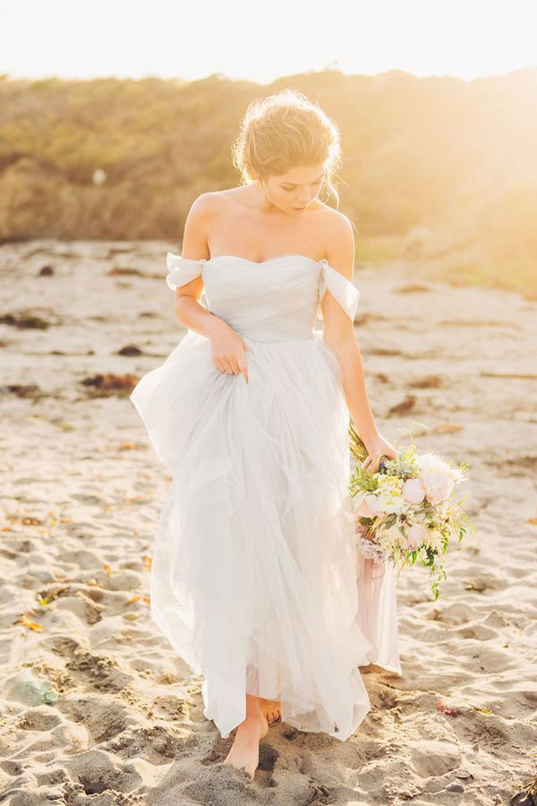 blue bridal gown - photo by Michelle Roller Photography http://ruffledblog.com/windswept-bridal-editorial-on-the-beach