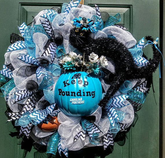 Check out this item in my Etsy shop https://www.etsy.com/listing/466652956/carolina-panthers-wreath-nfl-wreath
