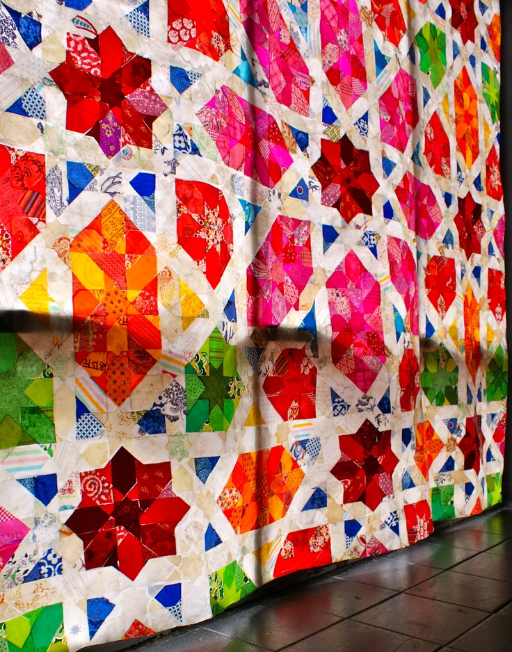 a window installation of waxed fabric and paper, based on an Islamic tile pattern