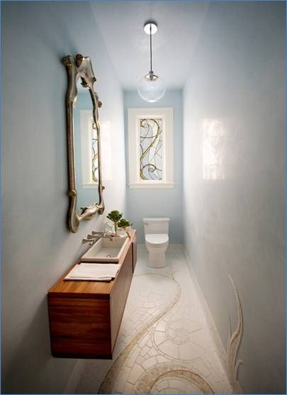 Bathroom makeovers for long skinny bathrooms narrow for Long bathroom ideas