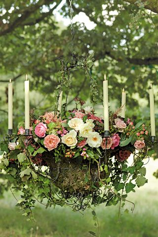 Chandelier filled with Country Roses, dill, astilbe, hydrangeas, phlox, chelone, Majolica spray roses, mint berried ivy, green ivy trails, astrantia and pittosporum, - outdoor party