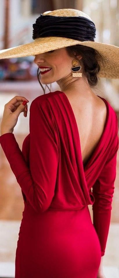 Classy lady with backless red dress. Love the hat, too