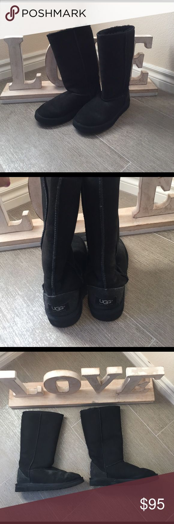 Tall black  kids UGG  boots Tall black UGG boots in good used condition. These were worn but still have a ton of life left in them. Feel free to ask any questions UGG Shoes